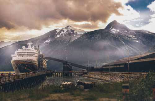 Cruise Ship In Port In Alaska With Mountains