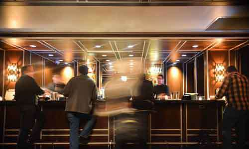 Men Standing At A Trendy Bar With Movement