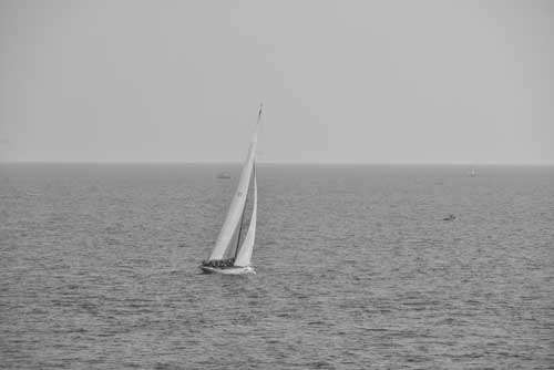 Black And White Racing Yacht At Sea