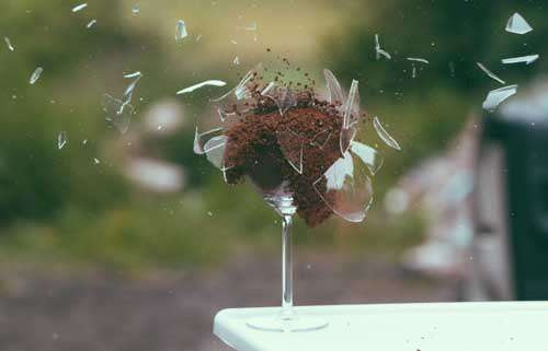 Exploding Wine glass Filled With Dried Coffee