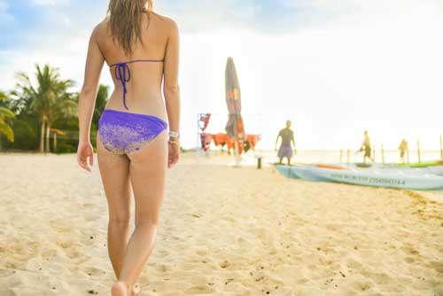 Surfer Girl Walking On Beach With Sandy Bikini