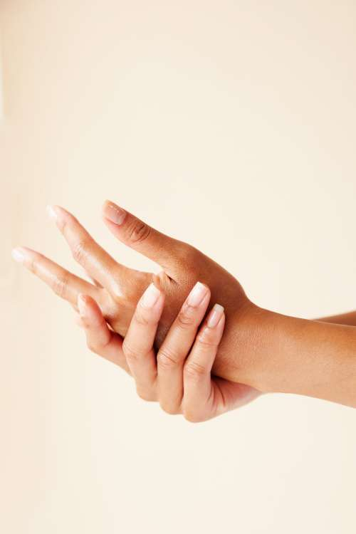 Two Hands Running In Skincare Treatment Photo