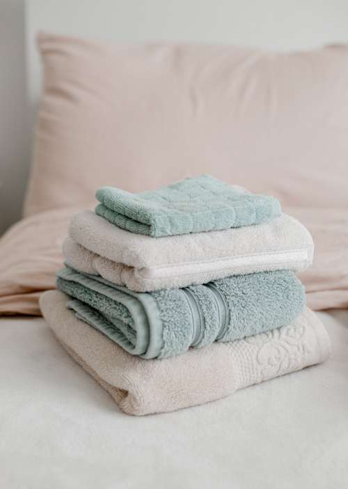 Folded Dusty Blue And Pink Towels Photo