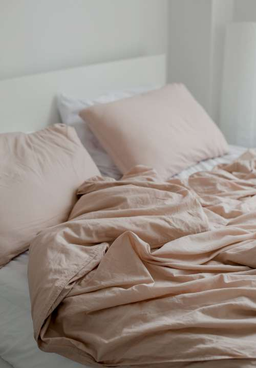 Unmade Dusty Pink Bedding Photo