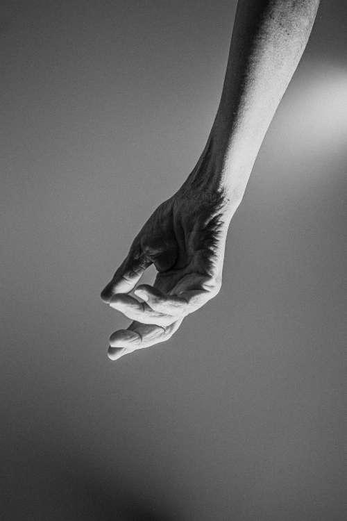Grainy Hand Falling Down Photo