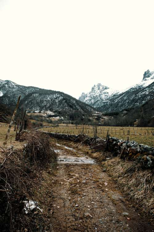 A Dirt Road Below The Mountains Photo
