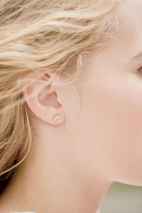Close Up Of Women Wearing Diamond Earring Photo