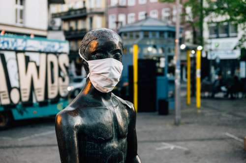 White Mask On A Statue Photo