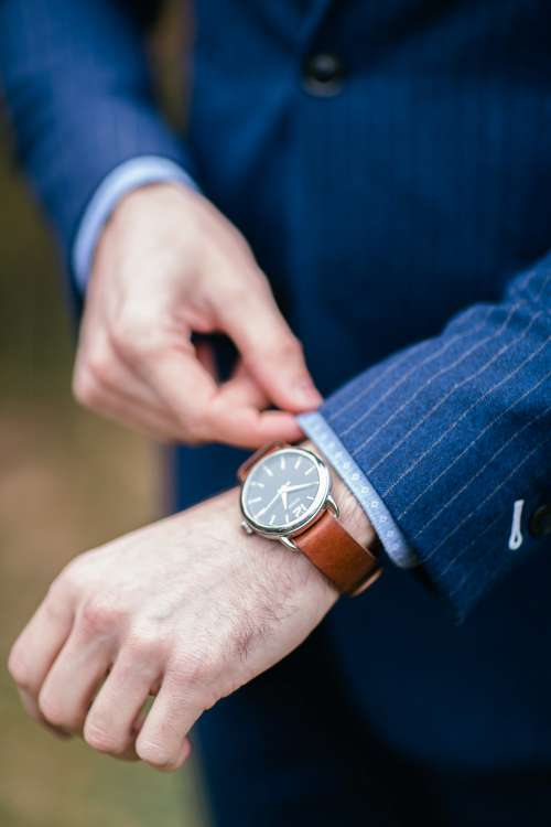 A Watch And Pinstripe Suit Photo