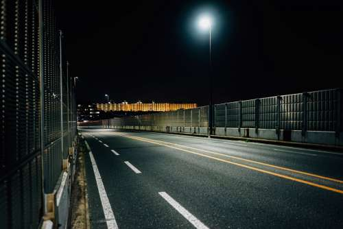 Empty And Enclosed Highway At Night Photo