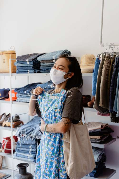 Young Woman Shopping With Face Mask On Photo