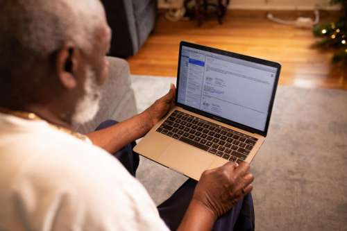 Man working on laptop at home in living room