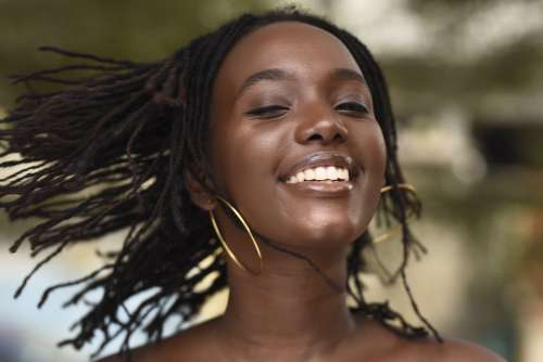 woman, people, fashion, pretty girl, mannequin, model, facial expression, joy, happiness, dreadlocks, smile, beauty, braids, rasta, wink, fun, hairstyle, haircut, look, aesthetics