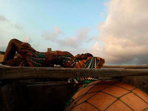 travel, people, beach, evening, landscape, pose, posture, gestural, boat, canoe, bark, rest