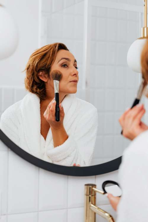 Skincare routine - Middle-Aged Woman in Bathroom