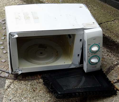 Discarded Faulty Microwave Oven