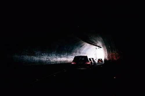 Red Eyes Looking Through Darkened Tunnel Photo