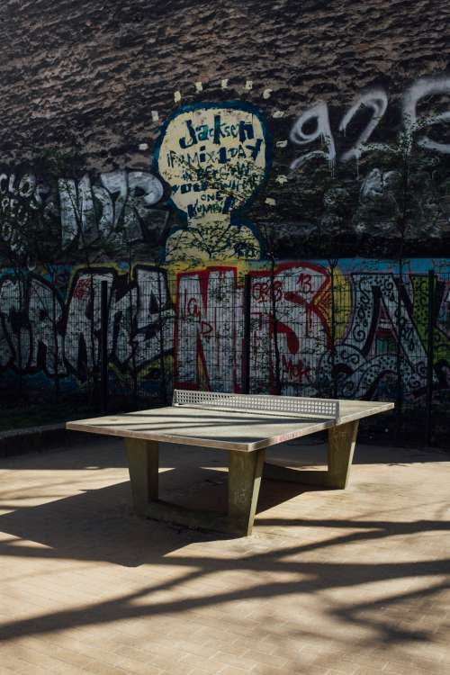 Ping Pong Table In Front Of Graffiti Wall Photo