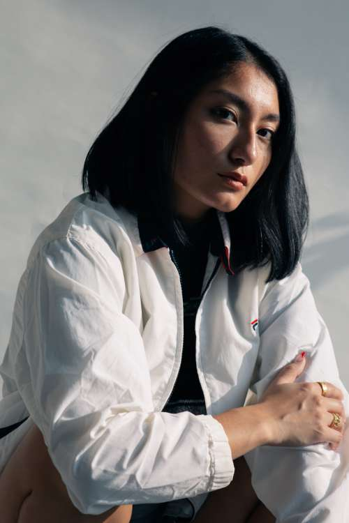 Close Up Woman Posing In White Casual Jacket Photo