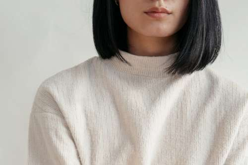 Close Up Showing Detail Of Cream Sweater Photo