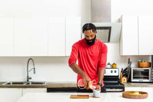 Man Makes Pour Over Coffee In Kitchen Photo
