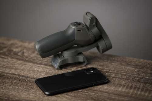 Mobile Phone And Small Gimbal Photo