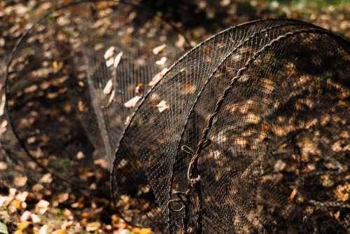 Fish net lying on the ground 2