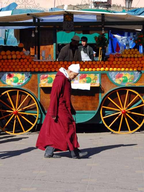 people, man, fruits, orange, chariot, walk, street vendor, work, pedestrian, street
