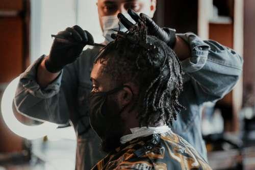 Man Getting A Hair Cut At Local Barber Photo