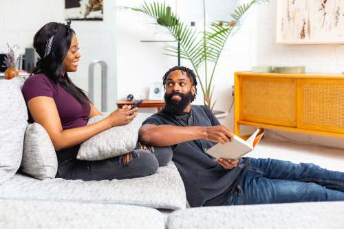 Couple Sits Relaxing In Living Room Photo