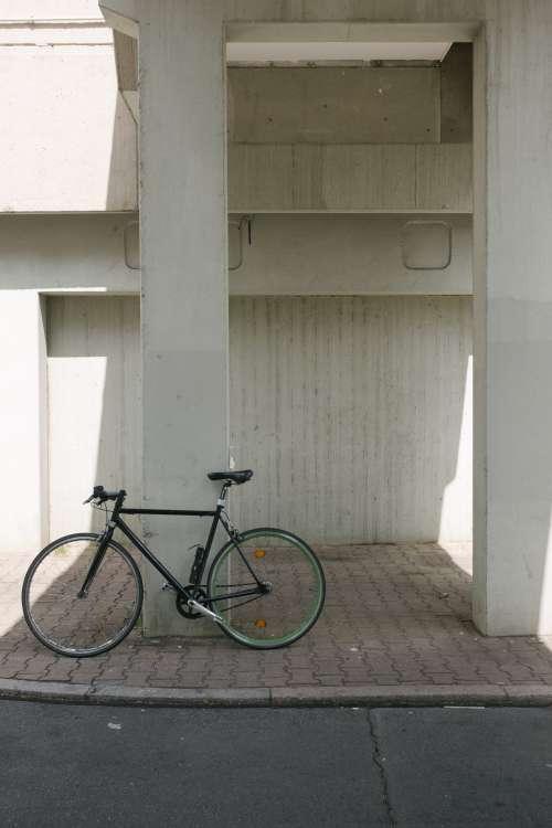 Bike Sits Against Concrete Column Photo