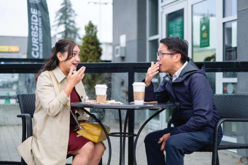 Couple Talking Outside In Cafe Patio Photo