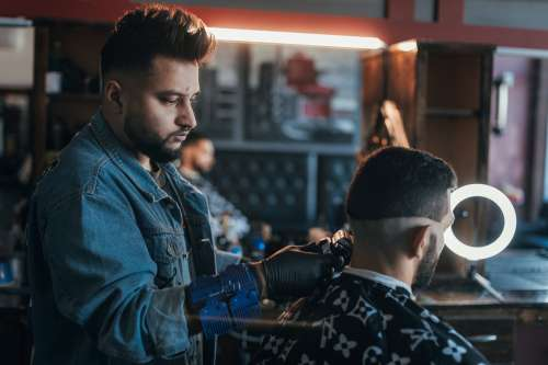 Barber Uses Clippers To Line Up Hair Photo