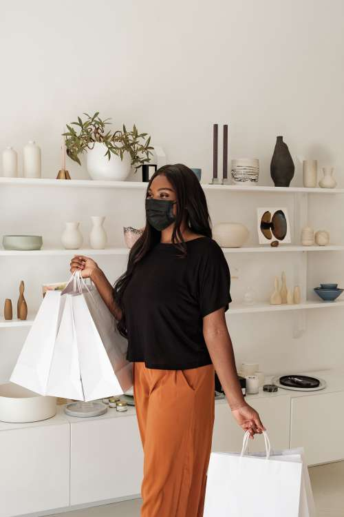 Happy Woman And Shopping Bags In Store Photo