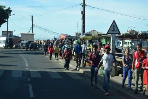 pedestrian crossing, traffic sign, people, men, women, facial expression, merchants, walkers, road, tar, city, urban, sidewalk, inhabitants