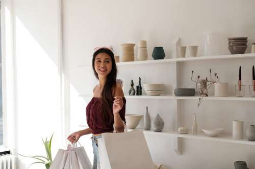 Woman With White Crisp Shopping Carrier Bags Photo