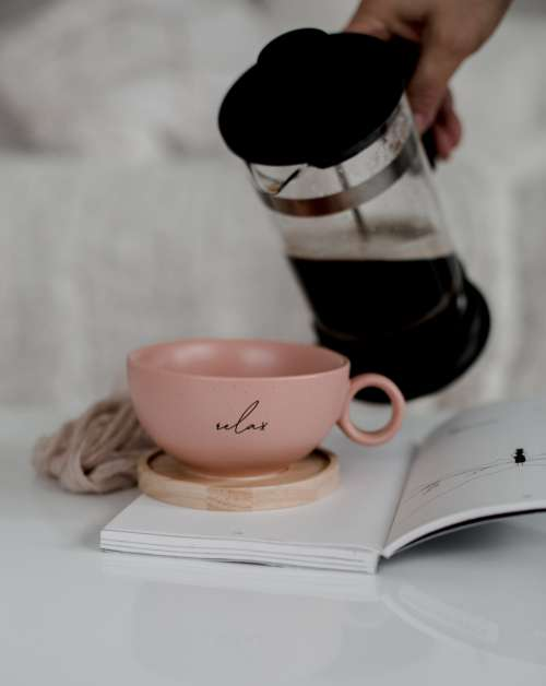 French Press Black Coffee And A Pink Cup Photo