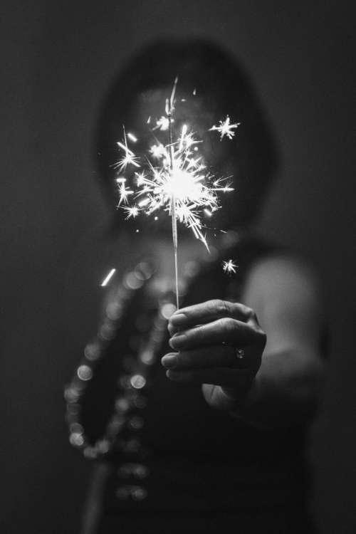 Woman Holding A Sparkler Celebrating 2021 Photo