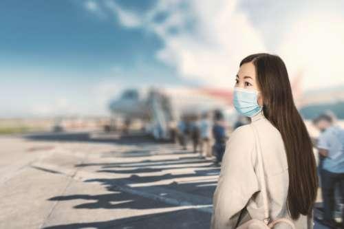 Airport Asian woman tourist boarding plane