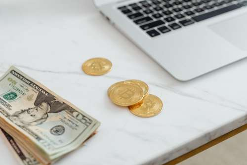 Finances - US Dollars and Bitcoins - Currency - Money