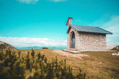 Stone Church On Grassy Hill Top Photo