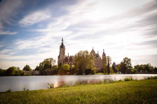 Green Grass By A Lake And Castle Photo