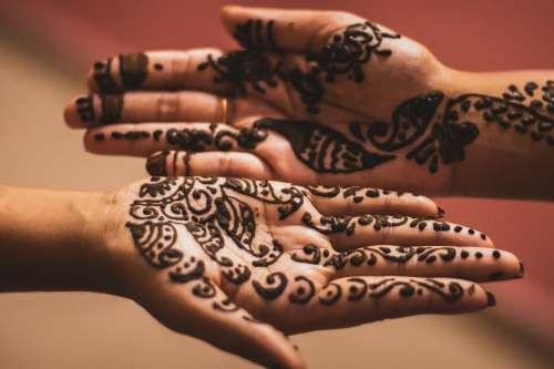 Drying Henna On Persons Palms Photo