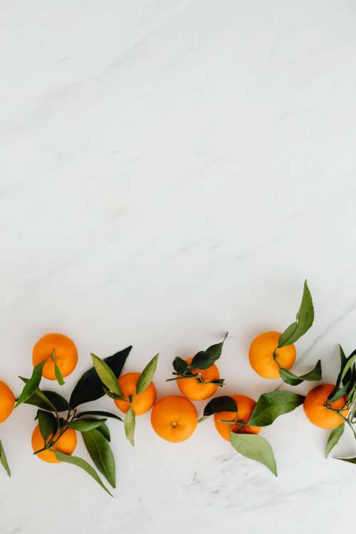 Mandarins on white marble