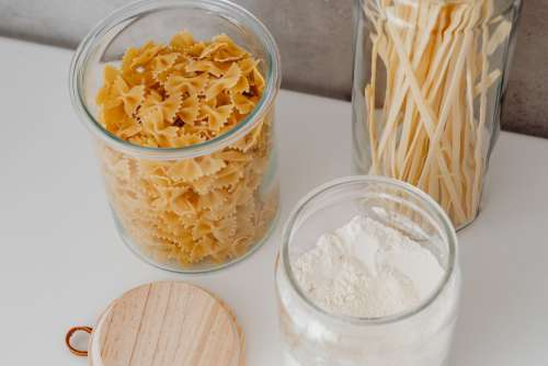 Eco-friendly kitchen utensils and food in jars