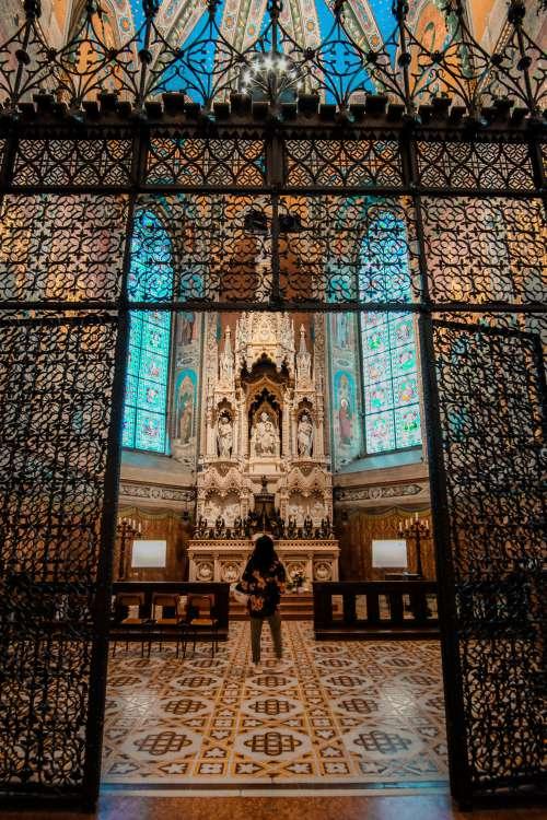 Person Admires A Sculpted Altar Photo