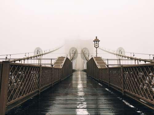A Wet Bridge Covered In Fog Photo