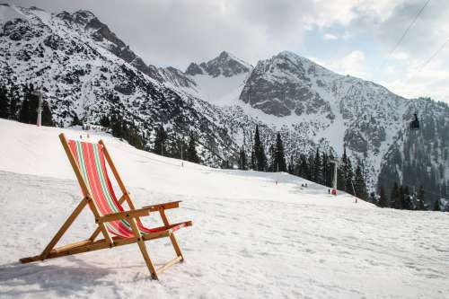 A Beach Chair On Snow Covered Mountain Photo