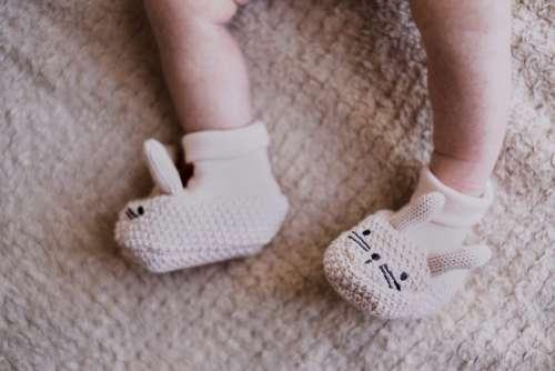 Bunny slippers on newborn's feet