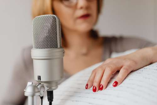 Woman Recording ASMR Sounds On Microphone